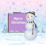 Снеговик стоит около доски Стоковая Фотография