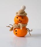 Снеговик tangerines на белой предпосылке Стоковые Фотографии RF