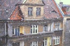 Снег и крыши старых домов Стоковые Изображения RF