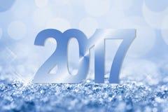 снег 2017 син и поздравительная открытка bokeh Стоковое Изображение RF