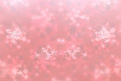 Снежинка и красная предпосылка текстуры Стоковое Фото