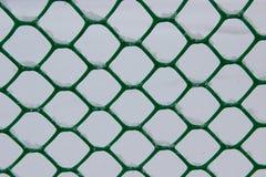Снежинки в клетках загородки сетки Стоковая Фотография RF