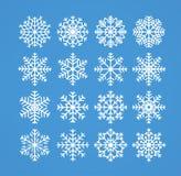 Снежинки, значки границы вечного снега рождества зимы морозные на голубой предпосылке бесплатная иллюстрация