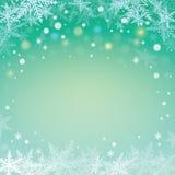 Снежинки Кристмас на зеленой предпосылке Стоковое Изображение