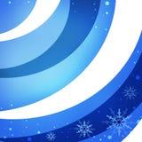 Снежинки на голубой предпосылке снега Стоковое Изображение RF