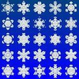 Снежинки на голубой предпосылке, украшения рождества/зимы Стоковые Изображения