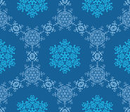 Снежинки на голубой предпосылке Стоковая Фотография RF