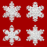 4 снежинки на красной предпосылке Стоковое Изображение RF