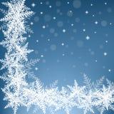 Снежинки рождества на голубой предпосылке Стоковая Фотография