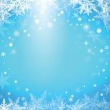 Снежинки рождества на голубой предпосылке Стоковые Изображения RF