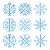 снежинки сини установленные На белой предпосылке иллюстрация штока