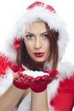 Снежинки счастливой содружественной женщины дуя Стоковое фото RF