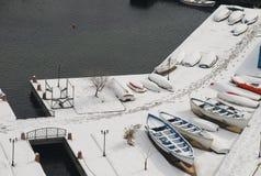 Снежок и шлюпки стоковое фото