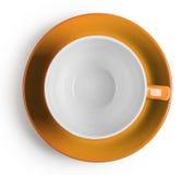 Снятая сверху оранжевая чашка с поддонником Стоковые Изображения RF