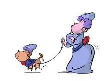 Собака женщины гуляя Стоковое Фото