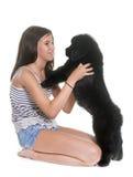 Собака и ребенок Ньюфаундленда щенка Стоковые Изображения