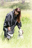Собака dressiruem девушки внешняя Стоковые Фото