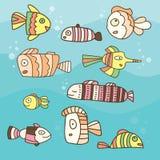 Собрание абстрактных рыб на голубой предпосылке иллюстрация штока