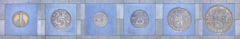 Собрание бывших голландских монеток в ряд Стоковые Фотографии RF