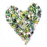 Собрание зеленых стеклянных бусин в форме сердца Стоковые Изображения RF
