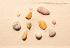 Собрание 11 камней моря на песке Стоковое Изображение RF