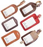 Собрание кожаных бирок багажа изолированных на белизне Стоковые Фото