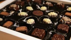 Собрание конфет шоколада акции видеоматериалы