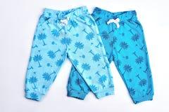 Собрание малышей брюк сделанных по образцу синью Стоковые Изображения RF