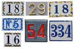 Собрание номеров дома на стене Стоковые Изображения RF