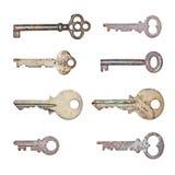 Собрание ржавых старых ключей в изолированной белой предпосылке Стоковые Изображения