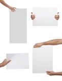 Собрание руки держа чистый лист бумаги изолированный стоковые фотографии rf