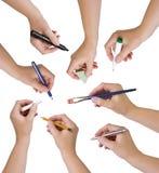 Собрание рук держа различные неподвижные объекты Стоковые Фотографии RF