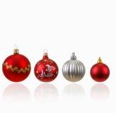 Собрание 4 шариков рождества на белизне Стоковые Изображения