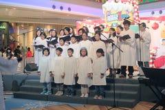 Событие Рожденственской ночи caroling в моле Гонконге домена Стоковое Фото