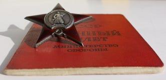 Советский заказ. Красный документ звезды и солдата стоковое фото rf