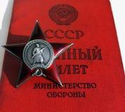 Советский заказ. Красный документ звезды и солдата стоковое фото