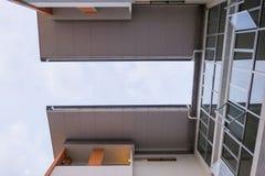 Современная картина высоких здания подъема и предпосылки неба Стоковая Фотография