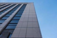 Современная картина высоких здания подъема и предпосылки неба Стоковые Фотографии RF