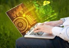 Современная компьютер-книжка с будущими символами технологии Стоковые Изображения
