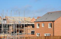 Современная строительная площадка строя современные дома. Стоковые Изображения RF