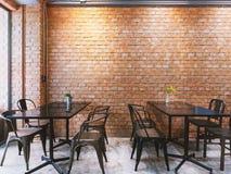 Современное кафе стиля просторной квартиры с черными комплектом и кирпичной стеной таблицы стоковое изображение rf