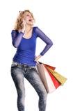 Современные покупки молодой женщины и говорить на клетке Стоковые Фото