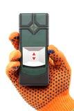 Современный лазер измеряя вровень в руке с перчаткой стоковые фотографии rf
