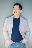 Современный азиатский усмехаться человека Стоковая Фотография