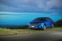 Современный голубой автомобиль седана стоковое изображение rf