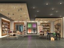 современный интерьер бутика с одеждами Стоковые Изображения