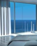Современный солнечный интерьер спальни с фантастическим взглядом seascape Стоковое Изображение RF