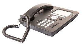 Современный телефон II настольного компьютера стоковое фото