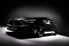 Современный черный автомобиль спорт в фаре на черной предпосылке Стоковые Фотографии RF