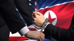 Соединенные Штаты санкционируют прикованный Северной Кореей конфликт оружий, политических или экономических сток-видео